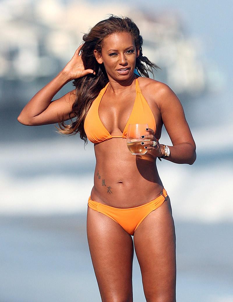 Melanie Brown shows off her bikini ass
