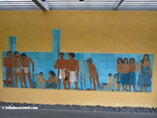 Mural about ancient Hawaiian life at park entrance