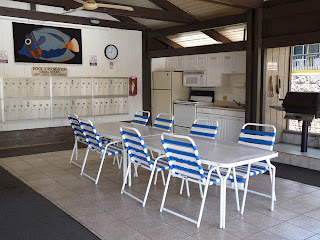 BBQ and kitchen in common area next to swimming pool