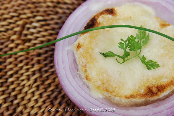 Soupe  l'oignon gratine (French Onion Soup) in onion bowls