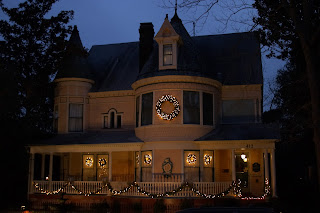 Nighttime Picture of C.W. Worth House Bed and Breakfast from the outside decorated for Christmas