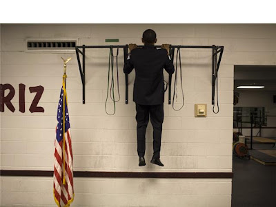 Barack Obama doing pull-ups, source unknown