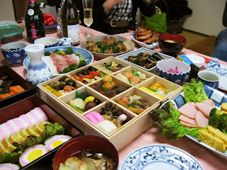 The gorgeous spread of traditional New Year's foods at Morinaga-san's house -- note the hard boiled eggs encased in fish paste on the left in the foreground.