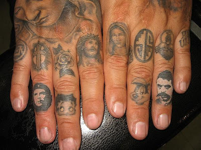 I was on the State of Grace blog and found these finger tattoos done by Ben