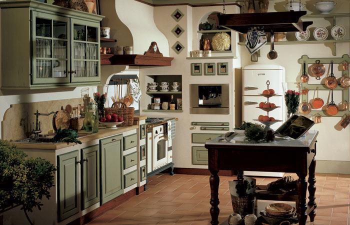 Cucina, in finitura color salvia, realizzata in legno di castagno, con ...