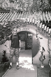 Noah in courtyard of Beijing Hutong