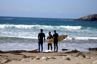 Dave, Joe & Noah going out surfing at Long Beach