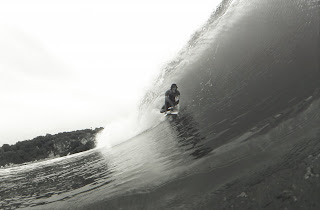 Justin Unsworth waving inside a barrel in Mexico