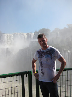 Chad getting soaked under the Iguassu Falls.