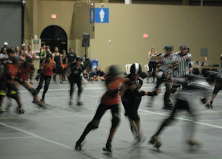 Elbows being thrown during the Roller Derby.