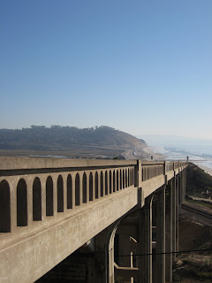 Bridge along bike ride with Torrey Pines visible in the distance.
