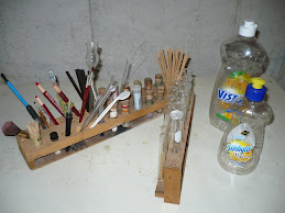 8) Wooden Racks and Plastic Water Bottles