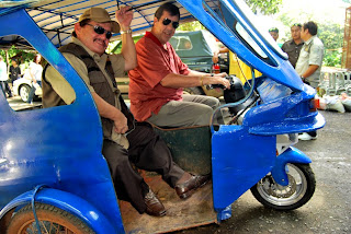 Dave Dewbre takes Mayor Ed Hagedorn of Puerto Princesa, Palawan on a ride on the new Etrkie prototype