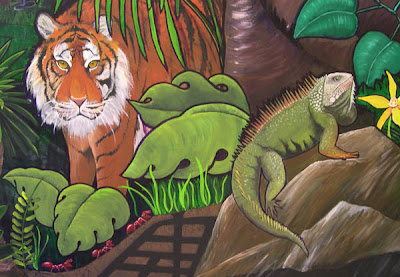This is a detail view of the tiger and iguana in our jungle mural.