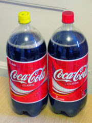 Passover Coke with sugar (yellow cap), high fructose corn syrup Coke (red cap)