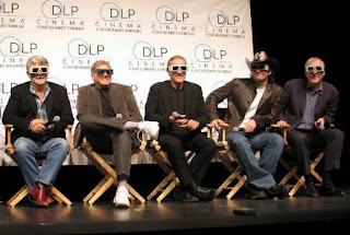 Lucas, Zemeckis, Rodriguez and Cameron wearing 3-D glasses