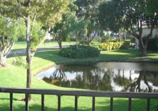 SOLD by Marilyn: Gorgeous BOCA LAGO  lake view from 2nd story Boca Lago condo