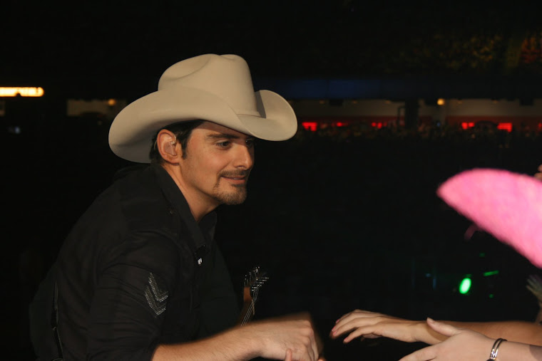 Tanner shaking Brad Paisley's hand at 2008 Houston Rodeo