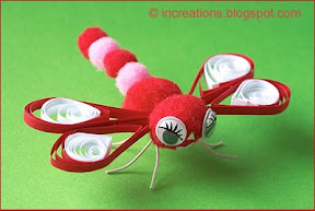 Dragonfly toy made of pompoms
