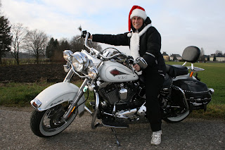 hot mrs claus on a harley davidson