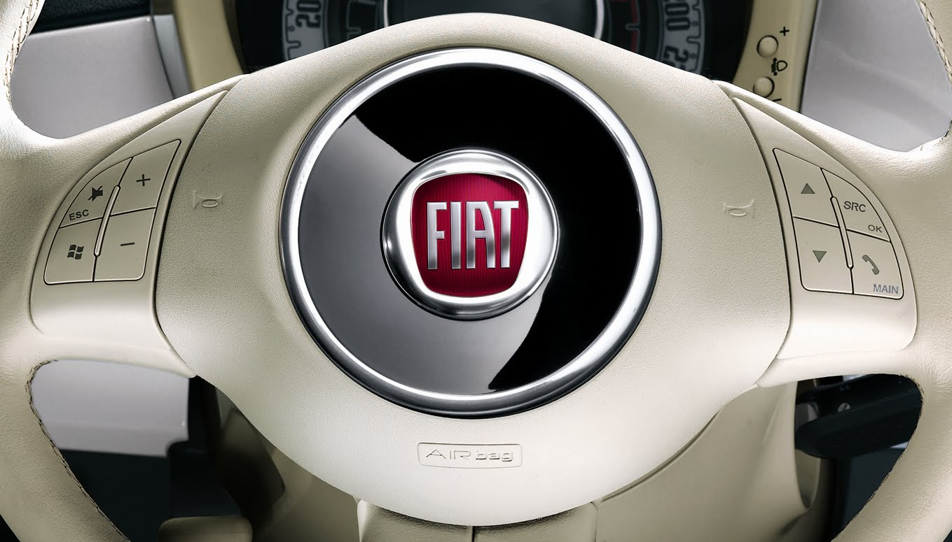 The us fiat 500 has cruise control with the control buttons having been added to the right side of the steering wheel these replace the radio controls of