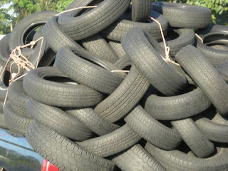 Tires loaded in pickup, La Ceiba, Honduras