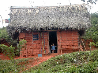 Honduran girl in clay house