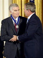 U.S. President George W. Bush presents actor Charlton Heston with the Presidential Medal of Freedom during a ceremony at the White House, in this July 23, 2003 file photo. Heston passed away at the age of 84, his family said on April 5, 2008. (Kevin Lamarque/Files/Reuters)