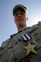 3/21/2008 9:38 AM, Cpl Ray Lewis, Marine Corps Air Ground Combat Center, Cpl. Ian M. Dollard, rifleman, wears the Silver Star Medal he received on Lance Cpl. Torrey L. Gray Field at Marine Corps Air Ground Combat Center March 21. Dollard braved enemy bullets to rescue his platoon commander from an enemy ambush during his deployment to Iraq in support of Operation Iraqi Freedom 06-08.