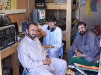 Sarwar and Islamuddin, the Bermel Radio station jockeys, located on Forward Operating Base Boris, Paktika province, broadcast religious services, play music, educational programs and spread news 13 hours a day to the local area.