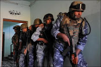 Iraqi police practice clearing a room on Nov. 1. Iraqi security forces are growing in combat strength and logistic capability, resulting in the lowest number of enemy attacks since January 2004.