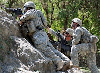Capt. John Williams (left), Commander of Headquarters and Headquarters Troop, 1st Squadron, 91st Cavalry Regiment (Airborne), observes the hill top while Staff Sgt. William Randall (center),directs Sgt. Shawn Seymour (right), a M-240B machine gun operator, during Operation Mountain Highway II April 27 in Nuristan Province Afghanistan. American, Afghan and Packistani troops are sqeezing terror groups in the border region. (U.S. Army Photo/Staff Sgt. Brandon Aird)