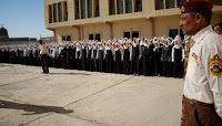 About 300 girls stand in formation in the courtyard of the Huda Girls School in Tarmiyah, northwest of Baghdad, during the official reopening Jan. 5. The school was under renovation since 2006. A foiled terror plot set back the opening by almost a year.