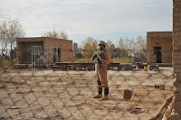 An Iraqi soldier from the 2nd Battalion, 19th Brigade, 5th Division, pulls security at an abandoned school yard in Naqib. The Iraqi army is partnering with U.S. Forces to clear the villages of Naqib and Bey'a and disrupt al-Qaida networks and weapons caches in and around the Diyala province of Iraq, on Dec. 19