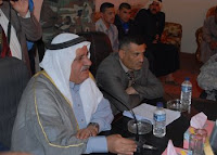 Sheik Sa'ed Jassim (left), a tribal and political leader in Tarmiyah, and Judge Nassir, the Tarmiyah Qada judge, speak with detainees in Tarmiyah March 16 during a detainee release. In conjunction with the Security Agreement, detainees without warrants are reconnected with their friends and families.