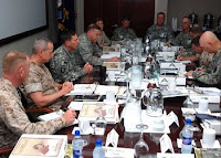 Gen. David Petraeus, Commander, U.S. Central Command, talks with regional U.S. commanders at the U.S. CENTCOM Commander's Conference. The conference is being held at U.S. Naval Forces Central Command in Bahrain May 20 - 22.