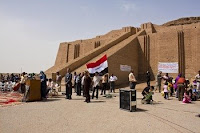 Iraqi citizens gather in front of the historical Ziggurat of Ur during a turnover ceremony at Contingency Operating Base Adder in southern Iraq, May 13. The site is now officially controlled and guarded by the Dhi Qar police and managed by the Ministry Of Tourism.