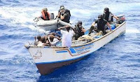Portuguese Navy Special Forces intercept a skiff filled with eight Somali pirates threatening a cargo ship in the Gulf of Aden June 22.
