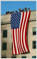 Men who hung our flag over the top of a building in defience of the cowardly attacks.