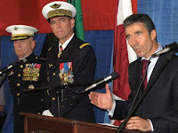 NATO Secretary General Anders Fogh Rasmussen, right, speaks with reporters as Marine Corps Gen. James N. Mattis, commander of U.S. Joint Forces Command, far left, and Gen. Stephane Abrial of the French air force, incoming commander of NATO's Allied Command Transformation, look on at Naval Station Norfolk, Va.