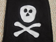 . the cutout skull and crossbones and carefully sew them down as close to .