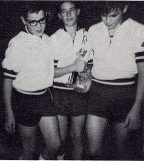 Gene Meyer, Bill Schwich and Steve Roettjer pictured as members of the basketball team accepting the second-place trophy at a basketball tournament in Bee, Nebraska. The photo is taken from the 1965-1966 yearbook of St John Elementary School in Seward, Nebraska