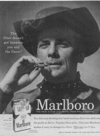 The Marlboro Man in an old advertisement. Image taken from http://motherpie.typepad.com/motherpie/2006/08/marlboro_going_.html