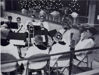 Brass band playing during Christmas Eve program of St John Church in Seward, Nebraska, in about 1966. The image was scanned from the 1966 school yearbook.
