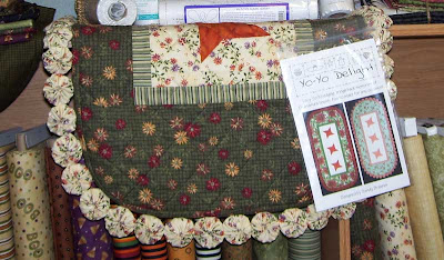 Yo-Yo Delight Table Runner Pattern by Sandy Brawner sample displayed at J&R Sewing in Fargo, ND