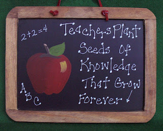 A CHALK BOARD THAT SAYS TEACHERS PLANT SEEDS...