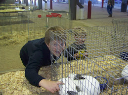 Trent Examines the Grand Champion Rabbits