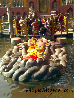 Hindus and Buddhists,lord in pond,lord with snake,god with snake,snake god,shree krishna, boulder,gigantic statue,stone carving