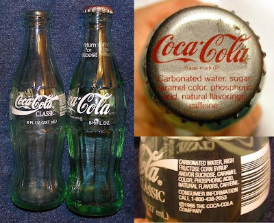 Coca-Cola Classic 8 oz. bottle from 1986 shown to left of original Coke 6-1/2 oz. bottle circa 1977. The original Coke ingredients (upper right) included only sugar and not the cheaper high fructose corn syrup and/or sucrose.