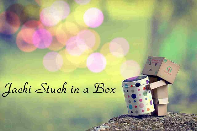 Jacki stuck in a box